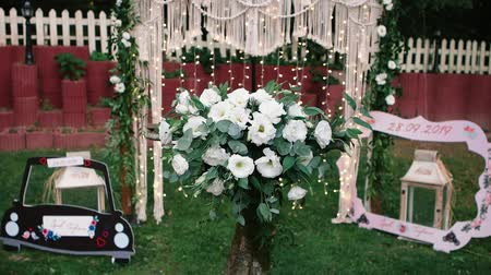 rusticana : Decorated wedding arch. Wedding ceremony in the woods.