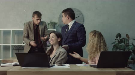 plagiarism : Indecent female office woman stealing completed colleague work and passing off to the boss as her own while working in modern office. Cheating worker stealing ready report from unaware coworker. Stock Footage