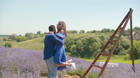 lavender field : Affectionate african american man with lovely smiling woman enjoying summer vacations and having fun while spending leisure together in lavender field, expressing happiness, joy and positivity.