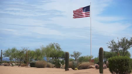 haladás : USA Flag Flying High in the Desert