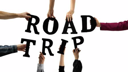 hippie : Hands holding up the letters to spell out the word ROAD TRIP. Stock Footage