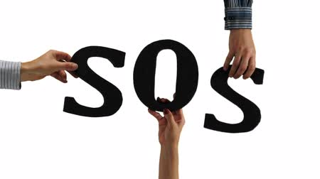 necessity : Letters Hands SOS Emergency Stock Footage
