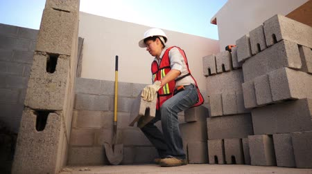 estrutura residencial : Woman Lifts Brick on Construction Site Vídeos