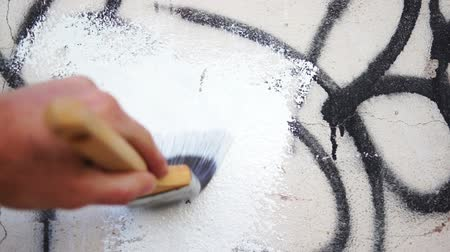 apodrecendo : Painting Over Graffiti Close Up Stock Footage