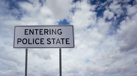 autoridade : Entering Police State Sign Clouds Timelapse