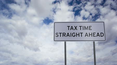 impostos : Tax Time Ahead Sign Clouds Timelapse Stock Footage