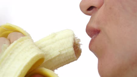 dudak : Female Eating a Healthy Banana Closeup Stok Video