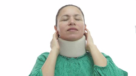 krk : Woman With Neck Brace In Pain