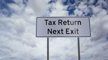 imposto : Sign Tax Return Next Exit Clouds Timelapse