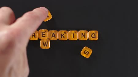 pletyka : Orange Letter Blocks Spell Breaking News