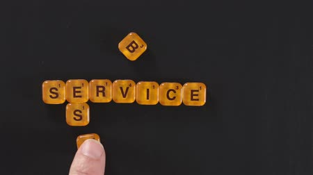 рекламный : Orange Letter Blocks Best Service Стоковые видеозаписи