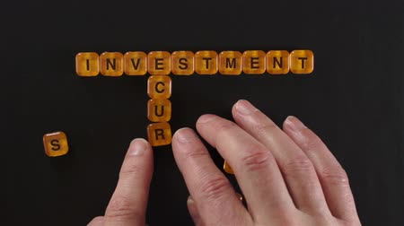 pieniądze : Letter Blocks Spell Investment Security Wideo