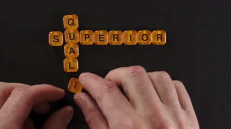 qualidade : Letter Blocks Spelling Superior Quality Stock Footage
