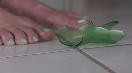 poškozené : Female Feet With Broken Glass on Floor Side View Dostupné videozáznamy