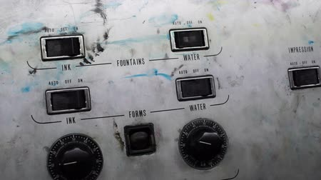 skvrny : Handheld shot of some of the ink stained controllers of an industrial offset presss electric controls. Dostupné videozáznamy