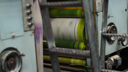 printings : Shot of the yellow printing drum on an industrial offset newspaper printing press.