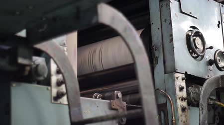 gazeta : Shot of the black printing drum on an industrial offset newspaper printing press.