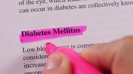 teste : Close up shot of a person that could be a doctor or a nurse highlighting the medical term or condition Diabetes.