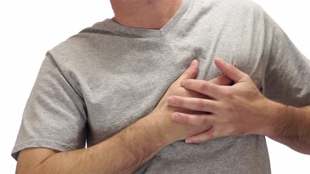 chest pain : Male figure isolated on a white background holding his chest in pain as if he is having a heart attack or cardiac arrest caused by factors like high cholesterol and stress.