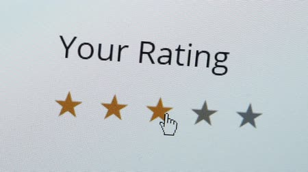 Close up shot of a computer screen with an online rating and review survey feedback poll getting an average three star review by the customer.