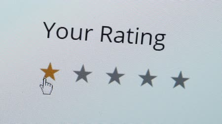 Close up shot of a computer screen with an online rating and review survey feedback poll getting a bad one star review by the customer.