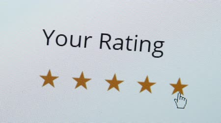 Close up shot of a computer screen with an online rating and review survey feedback poll getting an excellent five star review by the customer.