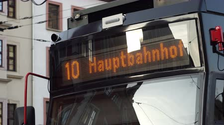 HALLE, GERMANY - APRIL 21, 2017: Handheld shot of a sign on a public transport rail train tram going to the Hauptbahnhof or main train station in Halle Germany. Stock Footage