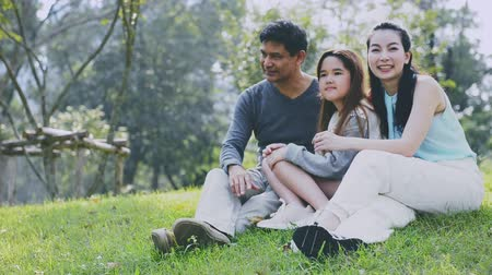 omini : Happy Asian Family enjoying their time in the park