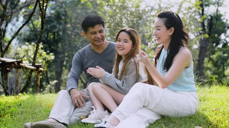 Happy Asian Family enjoying their time in the park