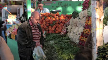 libra : HURGHADA, EGYPT - MARCH 20, 2015 Arabic traditional farmer market sell fresh fruits and vegetables on a covered bazaar on MARCH 20, 2015 in HURGHADA MARKET, EGYPT.