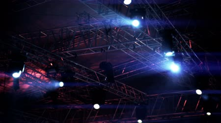 serseri : Stage vector lights, on live show concert Laser spotlight  rays on girder trusses beam with smoke Stok Video