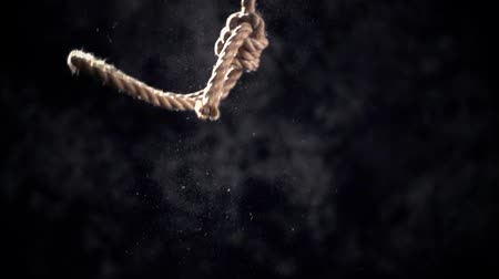 capital punishment : Rope noose with hangmans knot hanging in front of  black background. Stock Footage