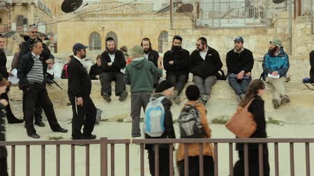 tallit : JERUSALEM, ISRAEL - FEBRUARY 10, 2015: A group of American Orthodox Jewish tourists spends meeting on roof of Old city of Jerusalem Stock Footage