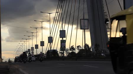 bangalore : Vehicles moving on a Hanging bridge seen on a cloudy evening in Bangalore, India. Right to left panning