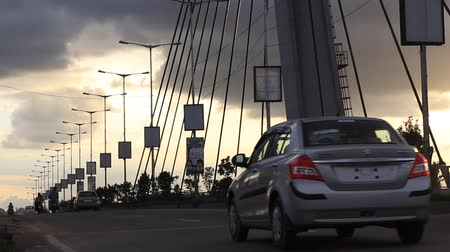 bangalore : Vehicles moving on a Hanging bridge seen on a cloudy evening in Bangalore, India. Bottom to top panning