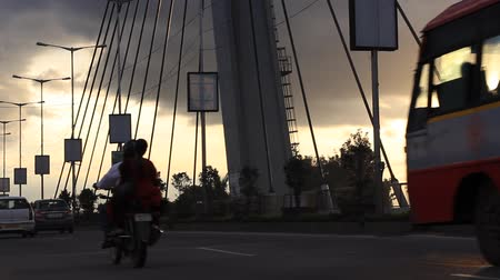bangalore : Vehicles moving on a Hanging bridge seen on a cloudy evening in Bangalore, India. Left to right panning