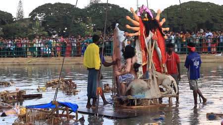 dussehra : Goddess Durgas idol immersing in water during Dussehra (Durga puja) festival in Bangalore, India