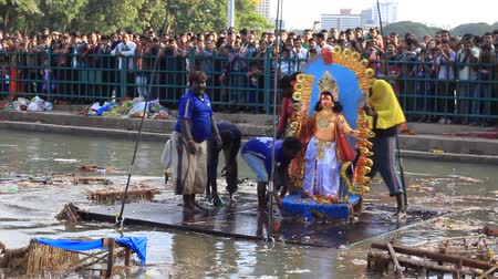 dussehra : Gods idol immersing in water during Dussehra (Durga puja) festival in Bangalore, India Stock Footage