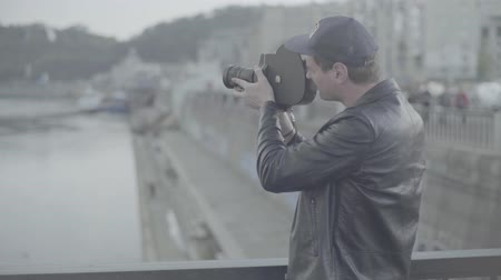 dop : A male (man) cameraman shoots video on an old vintage camera Krasnogorsk. Kyiv. Ukraine