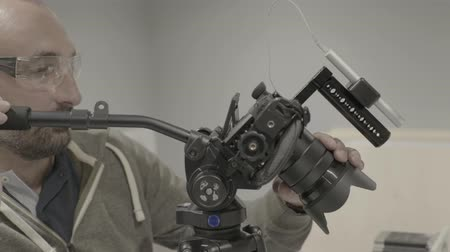 filmmaker : Close-up of a DSLR camera in the hands of a cameraman (photographer) while shooting a video (photo)