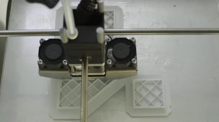 Technology. The work of a three-dimensional printer. 3D printer during printing close-up. Process of working 3D printer.