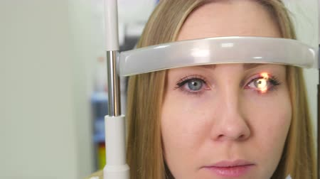 astigmatism : Verification of The Women Eyes with a Slit Lamp on Modern Equipment Stock Footage