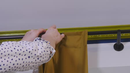 glass master : Master hangs curtains in a room Stock Footage