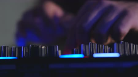 tweak : Djs hands playing mix on sound board