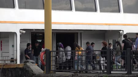 docking : istanbul, Turkey - May 2018: Unidentified commuters get on board at Kadikoy Port in Istanbul. Nearly 150,000 passengers use ferry daily in Istanbul that has lands on two different continent