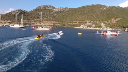 Киклады : Marmaris, Turkey - September 2018: Amazing view to yachts sailing in open sea at sunny day with people swimming and doing watersports, Marmaris, Turkey