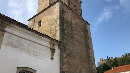 yaldız : Nazare, Portugal, April 2018: Bell tower of the St. John Baptist church in Tomar, Portugal Stok Video