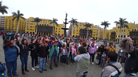 lima : Lima, Peru - September 2017: Children singing and having fun together near Plaza Mayor, Plaza de Armas of Lima, the Historic Centre of Lima, Peru