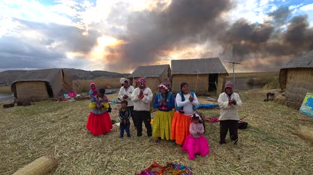 native american culture : Titicaca, Peru - September 2017: Natives of Titicaca lake dancing and singing in traditional dresses on floating islands