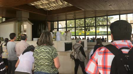 marian : Fatima, Portugal - April 2018: People attending the prayer session in the small shrine located near Sanctuary of Our Lady of Fatima, Basilica of Nossa Senhora.